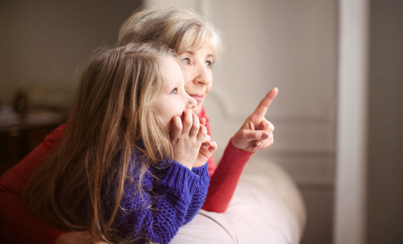 Grandma pointing with granddaughter